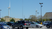 Fairhaven's turbines loom behind the Stop & Shop (right side) parking lot