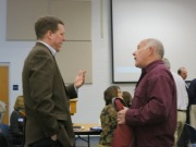 Neil Andersen, on right, discusses a point with Andy Brydges before meeting. Photo by Kurt Tramposch.