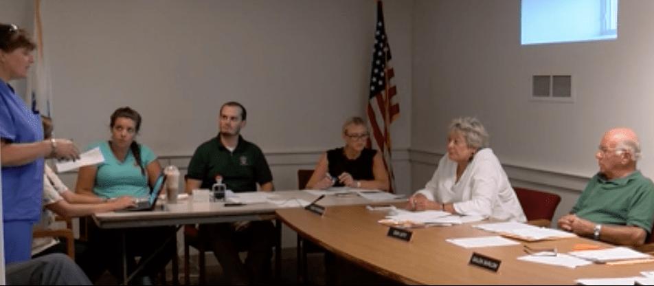 Facing the BOH chair, Karen Gibides presents noise complaint information